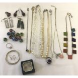 A collection of vintage and modern costume and silver jewellery.