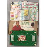 A vintage boxed Casdon Soccer Bobby Charlton game.