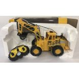 A boxed remote control 1:10 scale construction vehicle.