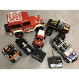 A box of remote control vehicles to include a monster truck and dune buggy.
