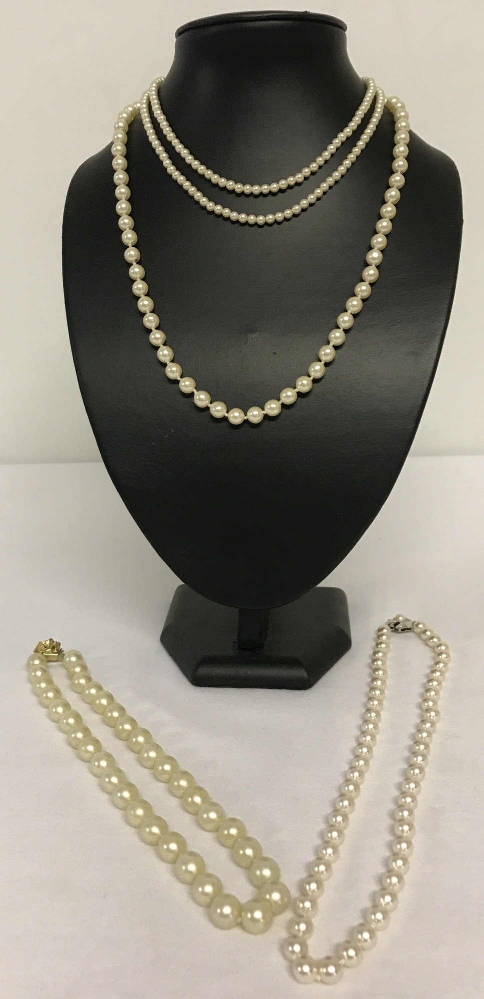 Lot 21 - 4 vintage faux pearl necklaces all with decorative clasps. One marked 925.