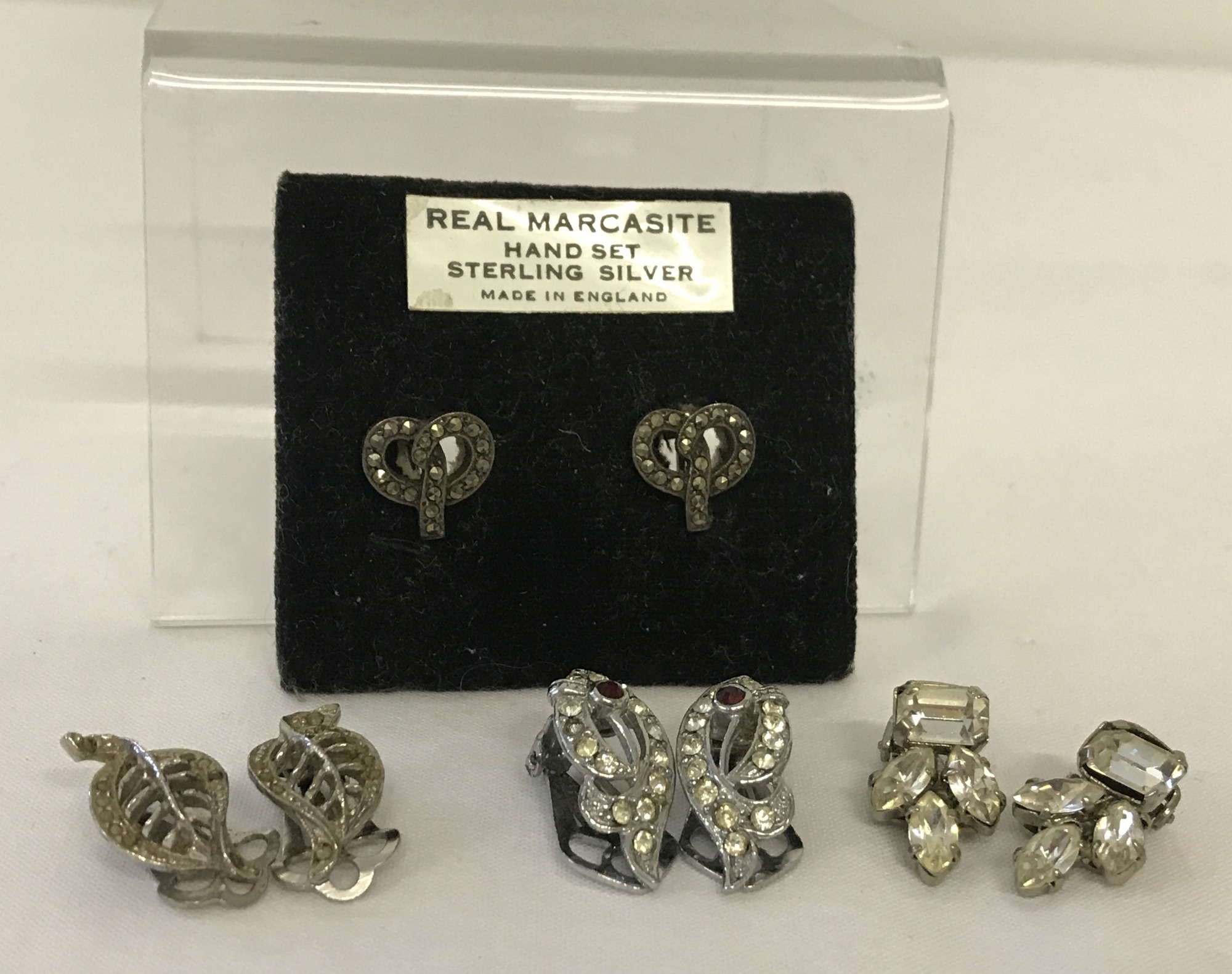 Lot 15 - A pair of vintage silver screw back earrings set with Marcasite's stones.