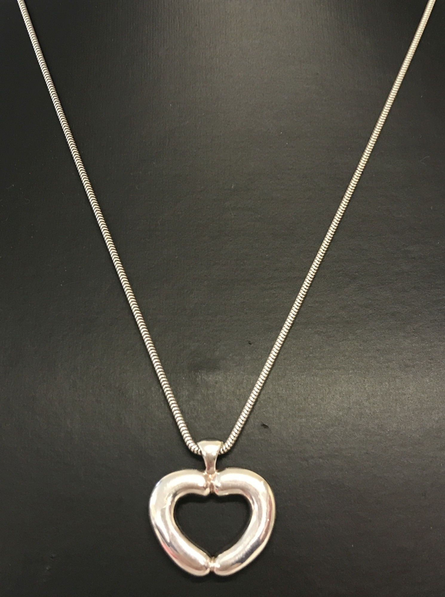 Lot 25 - A boxed 'Tomfoolery' silvery contemporary style heart necklace by Theo Fennell.