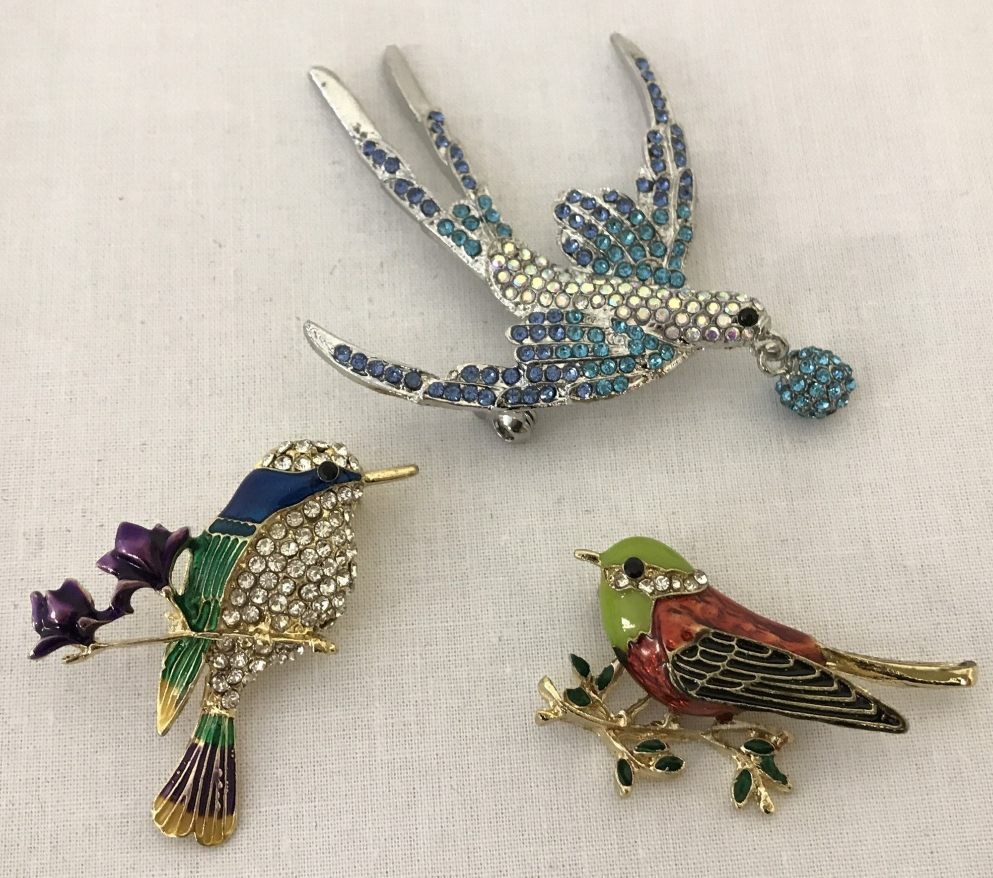 Lot 22 - 3 costume jewellery enamelled and stone set brooches in the shape of birds.