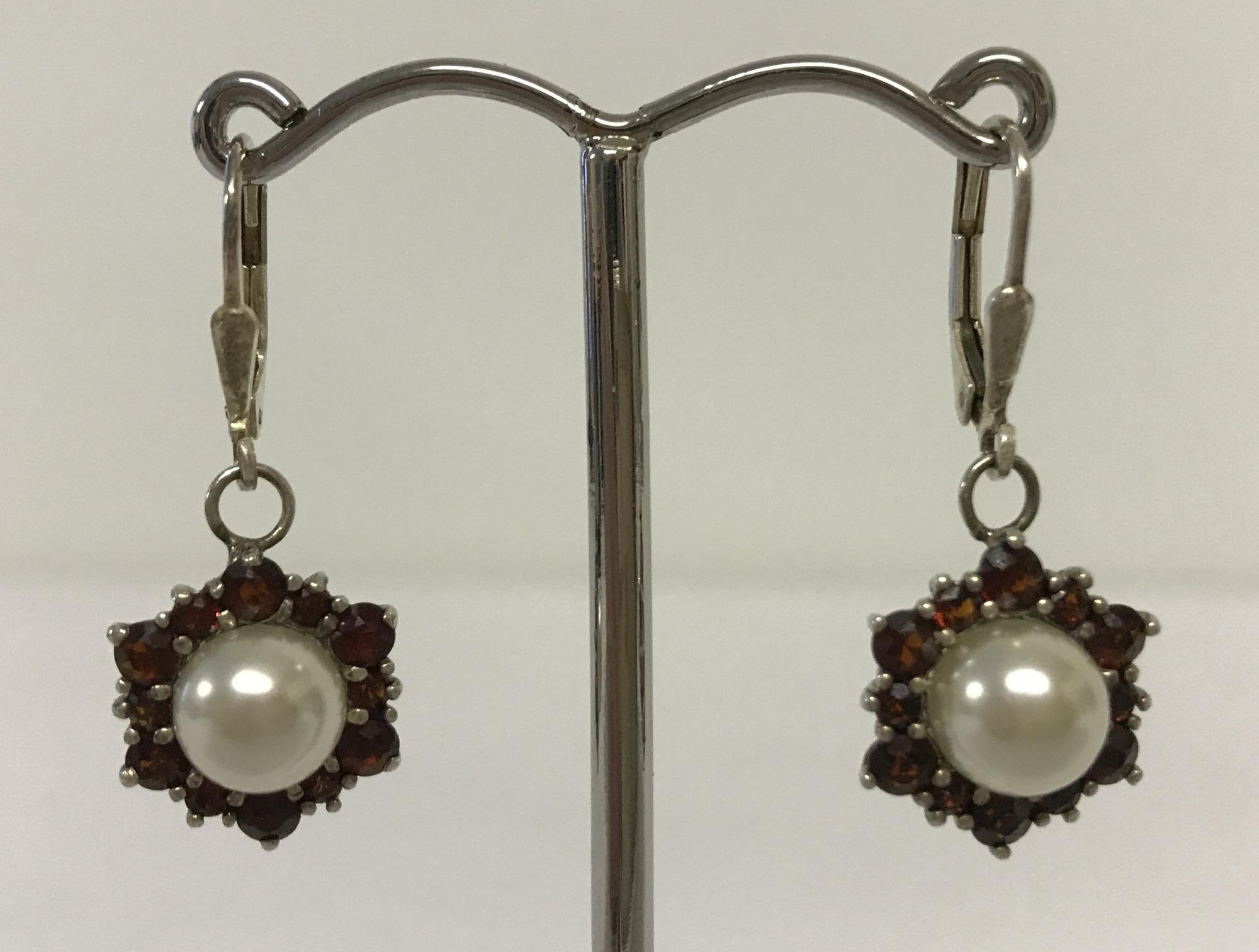 Lot 19 - A pair of faux pearl and garnet drop earrings.