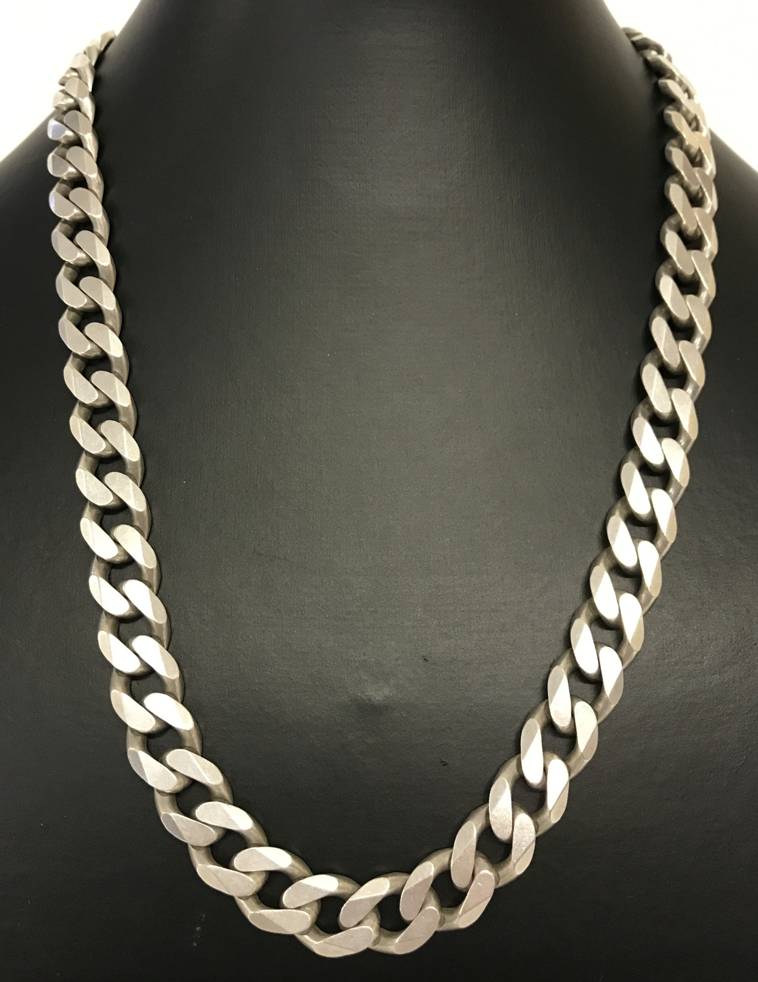 Lot 45 - A heavy curb chain necklace with lobster clasp.