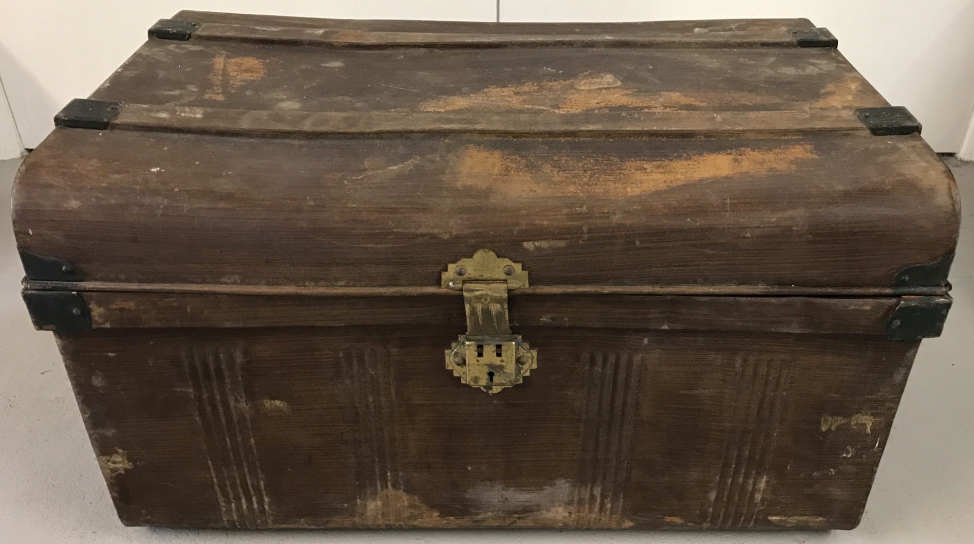 Lot 92 - A Victorian metal travelling trunk with carry handles and brass latch/lock fixings.