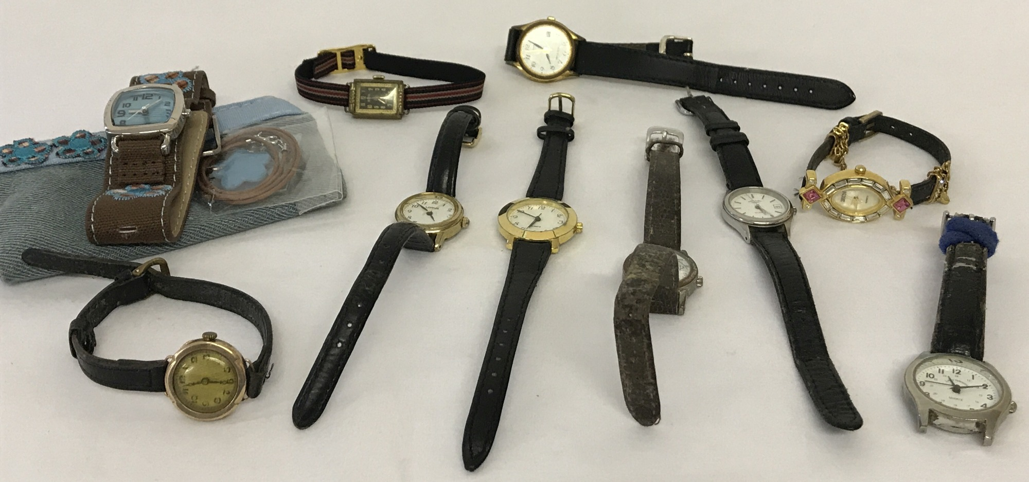 Lot 65 - A collection of 10 ladies wristwatches to include vintage gold cased watch.