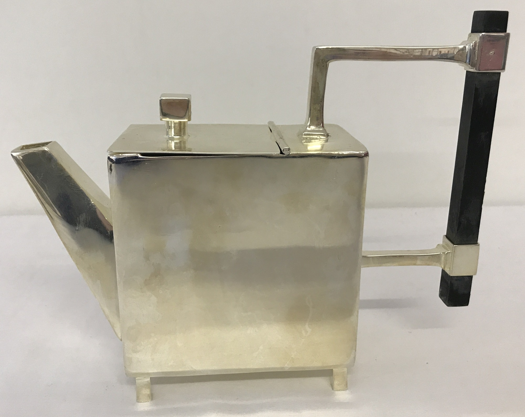 Lot 72 - An Art Deco style silver plated teapot with wooden handle.