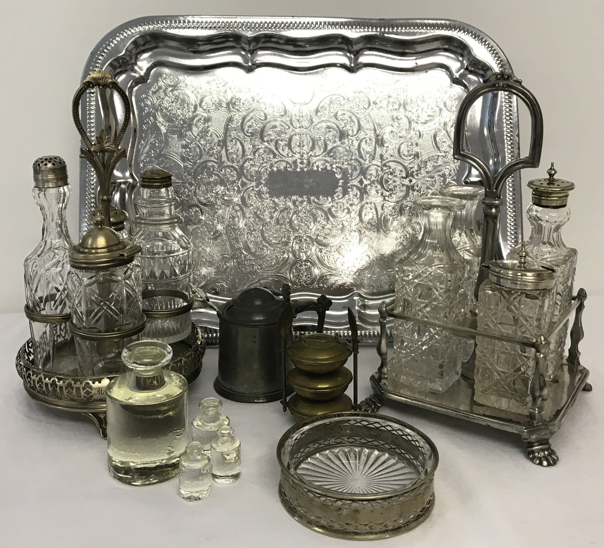 Lot 70 - 2 silver plated and cut glass cruet sets in stands.