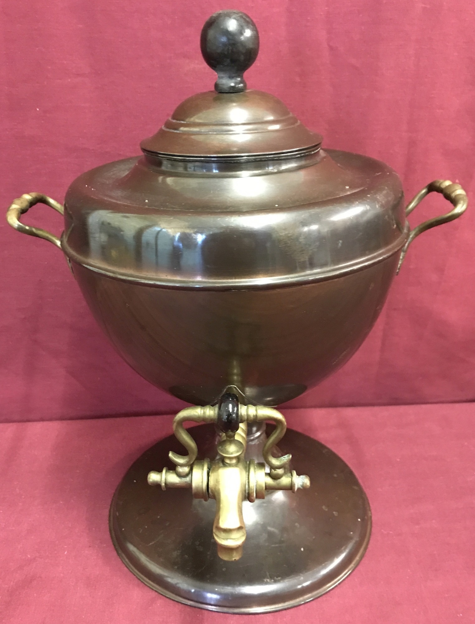 Lot 90 - A vintage copper samovar with brass handles and tap and wooden finial.