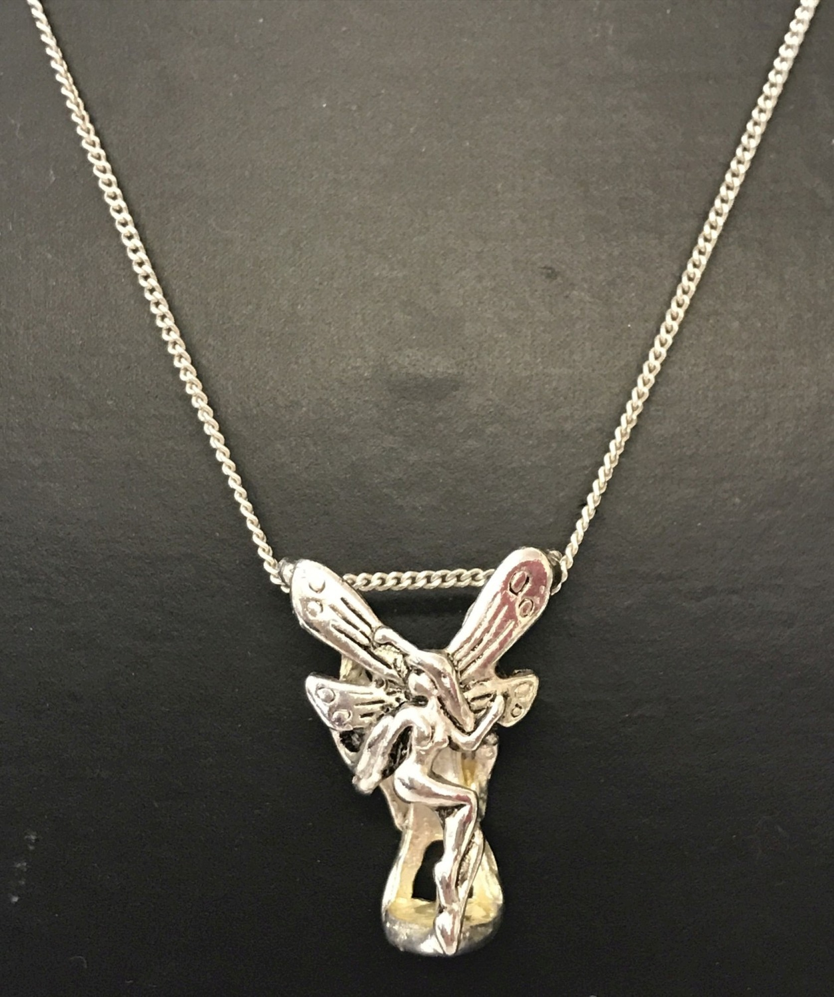 "Lot 11 - An Art Nouveau style 3 dimensional fairy pendant on a silver 18"" fine curb chain."