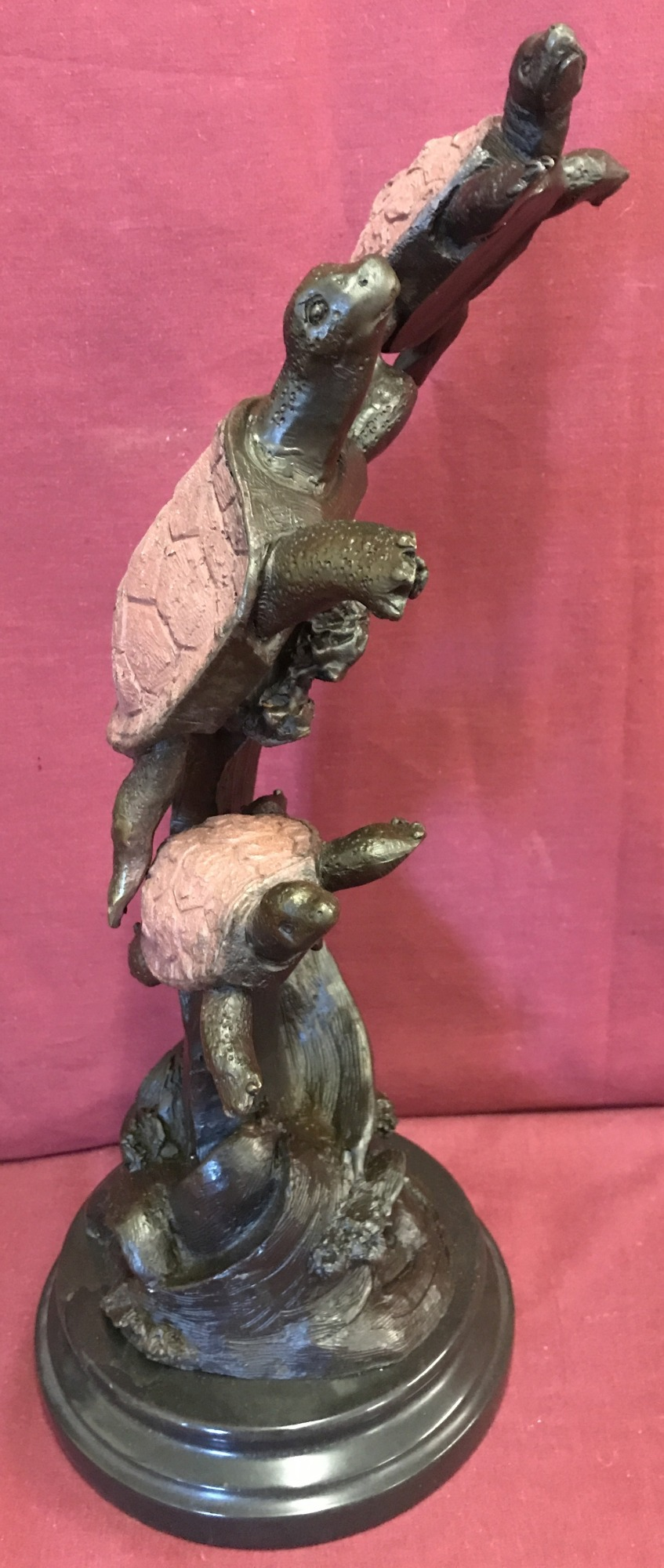 Lot 96 - A large bronze figurine of swimming turtles, mounted on circular marble plinth.