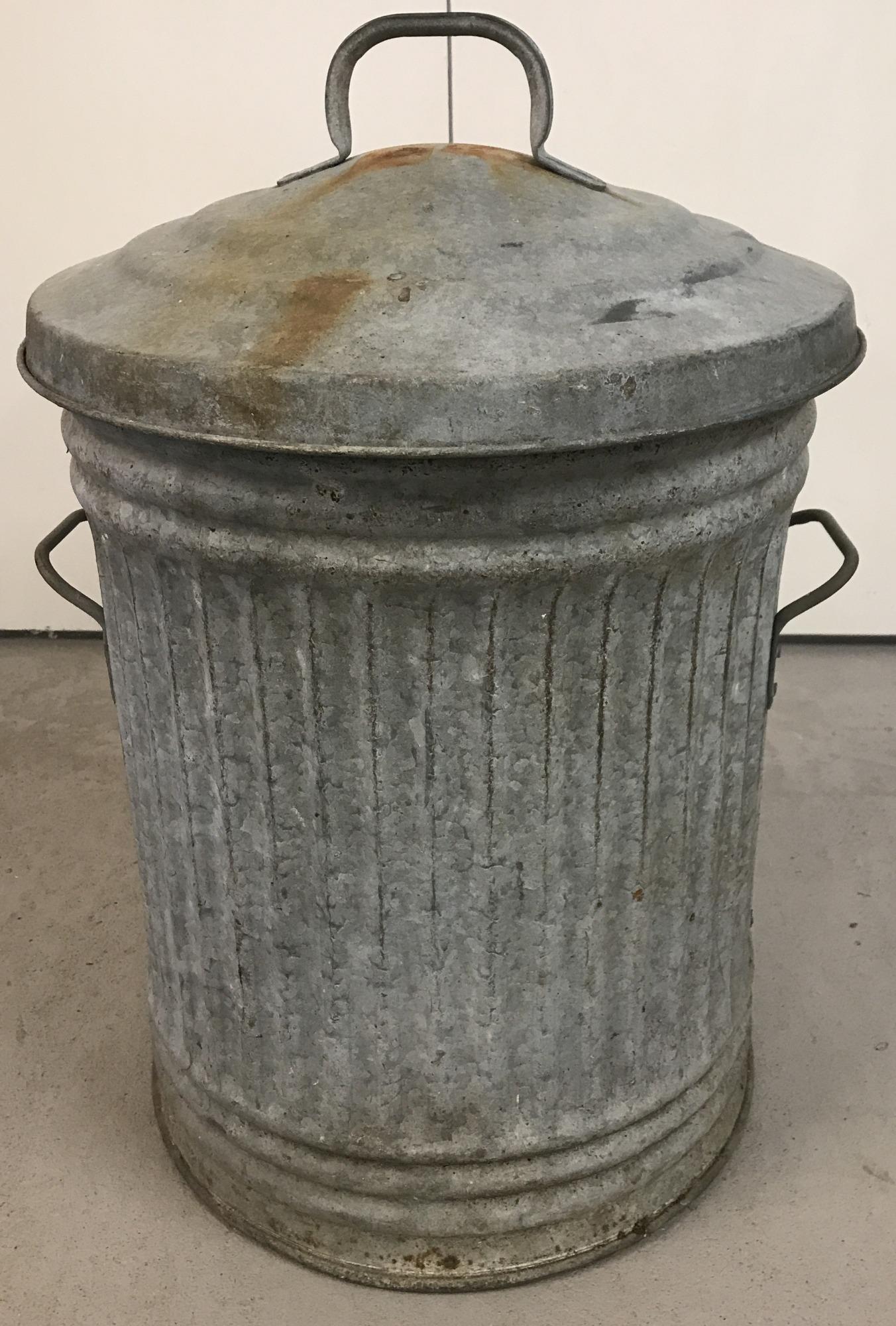Lot 88 - A vintage galvanised 2 handled lidded dustbin.