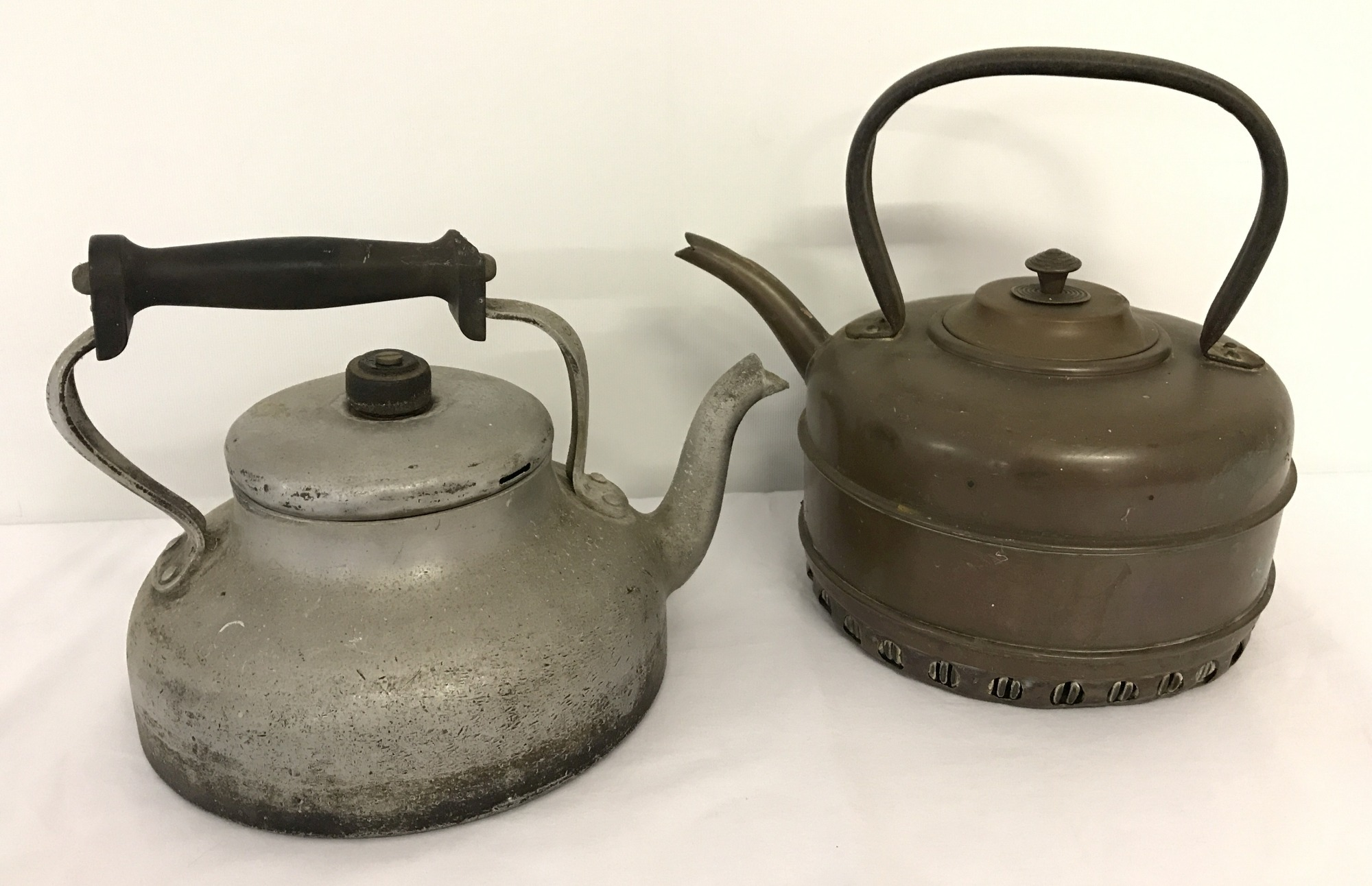 Lot 93 - A vintage Aga aluminium stove top kettle together with a vintage gas stove copper kettle.