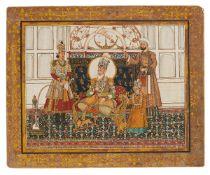 An enthroned Raja smoking a Huqqa in palace chambers