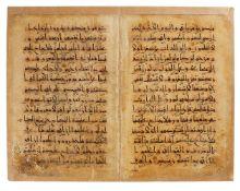 Eastern Kufic bifolium, from a Seljuk Qur'an, in Arabic, with interlinear translation in Farsi, illu