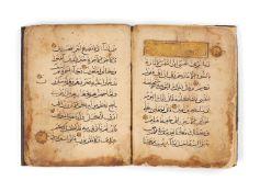 Ɵ Section of a Mamluk Qur'anic Juz', in Arabic, illuminated manuscript on paper