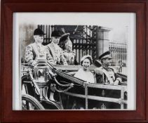 Queen Elizabeth II and the Shah of Iran riding in a coach through the gates of Buckingham Palace