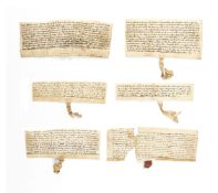 Collection of medieval charters, all in Latin, manuscript documents on parchment