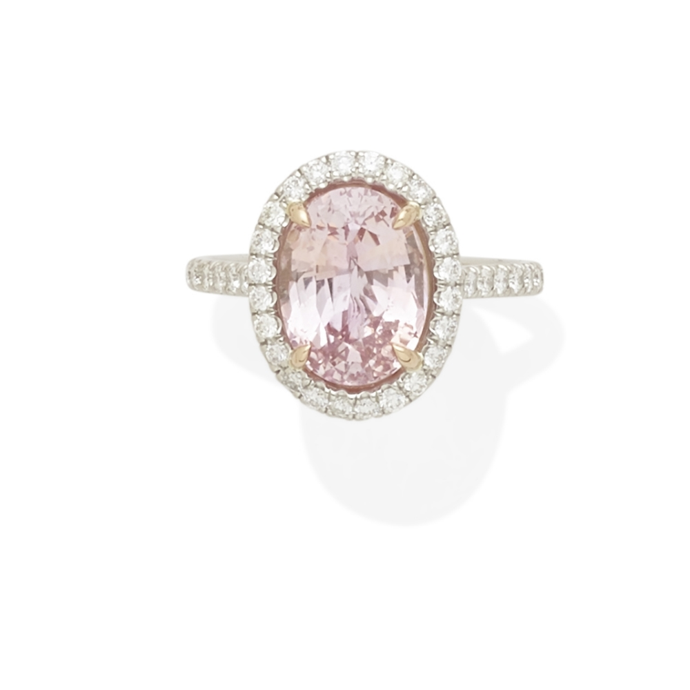 Lot 45 - A padparadscha sapphire and diamond ring