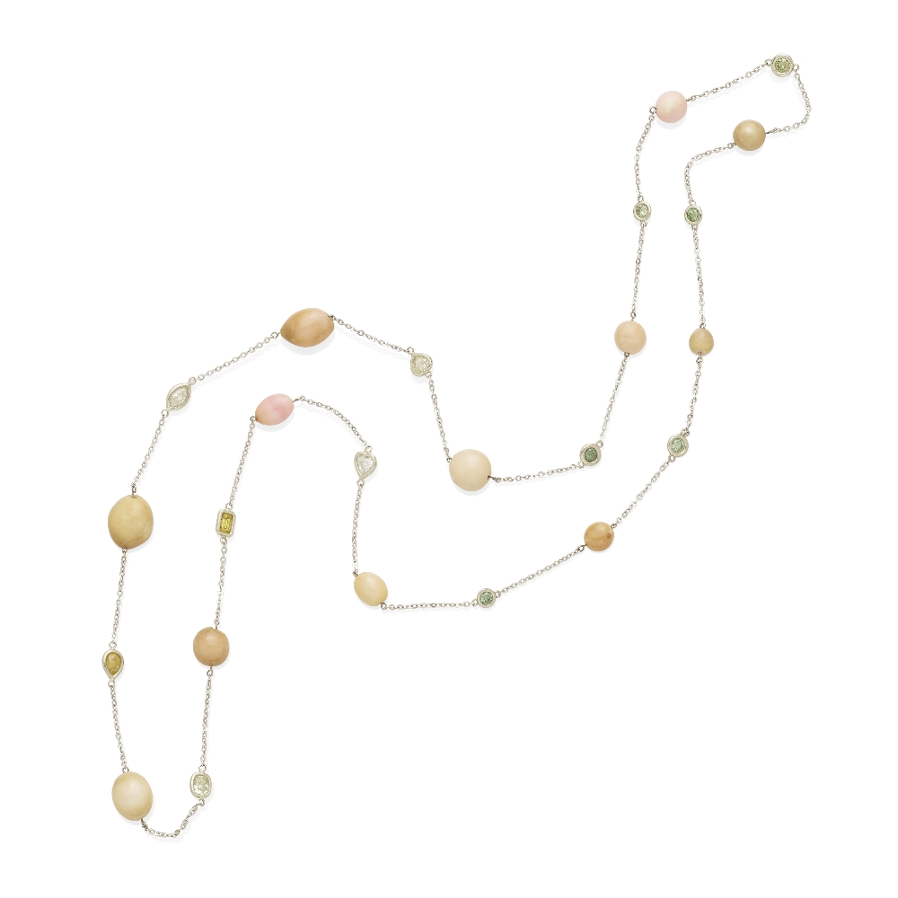 Lot 44 - A conch pearl and colored diamond station chain