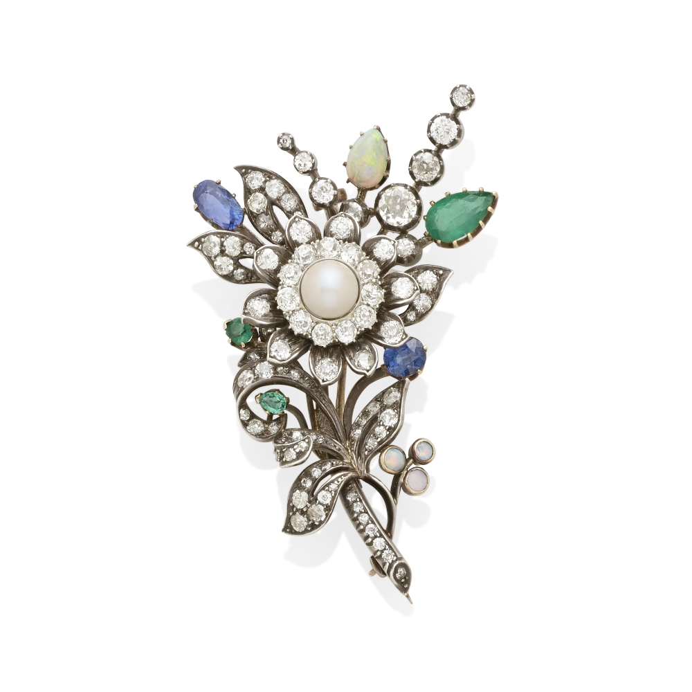 Lot 43 - A diamond and gem-set brooch