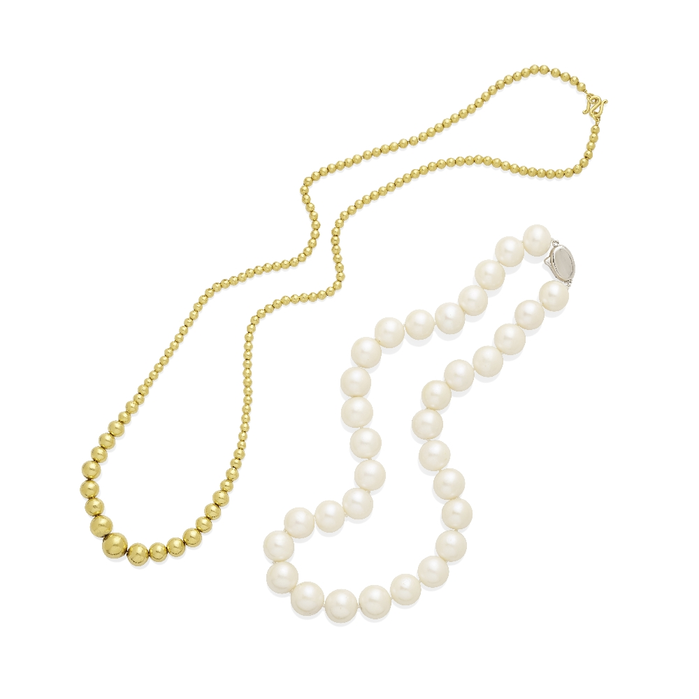 Lot 3 - A cultured pearl necklace and gold bead necklace
