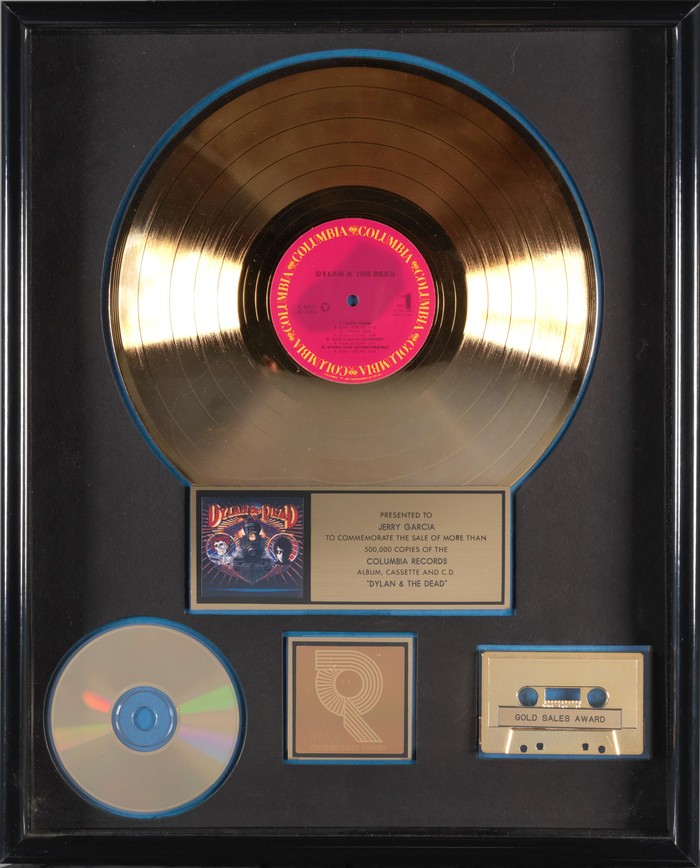 Lot 355 - A JERRY GARCIA 'GOLD' SALES AWARD FOR THE BOB DYLAN / GRATEFUL DEAD ALBUM DYLAN & THE DEAD 1989