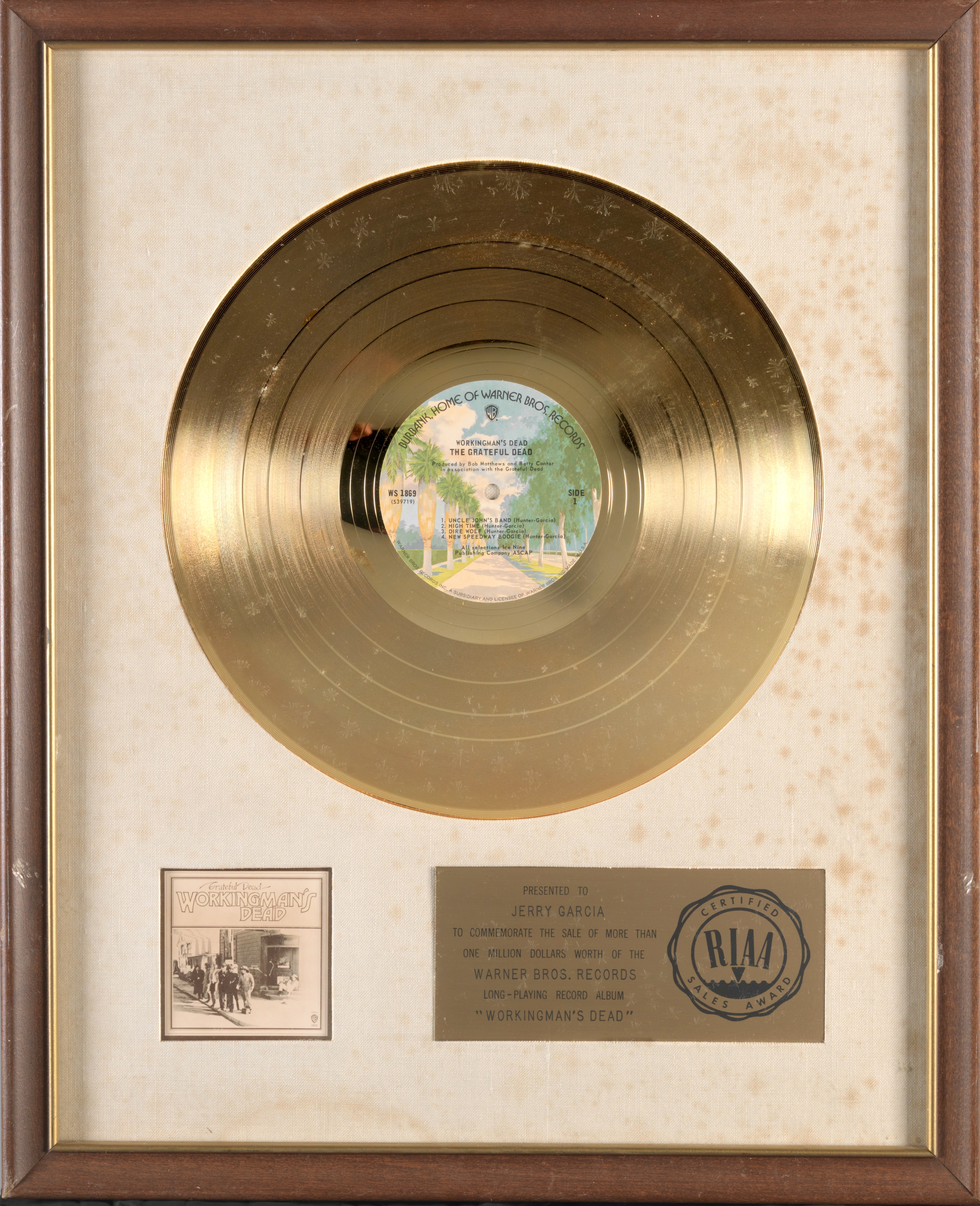 Lot 320 - A JERRY GARCIA 'GOLD' SALES AWARD FOR THE ALBUM WORKINGMAN'S DEAD 1974