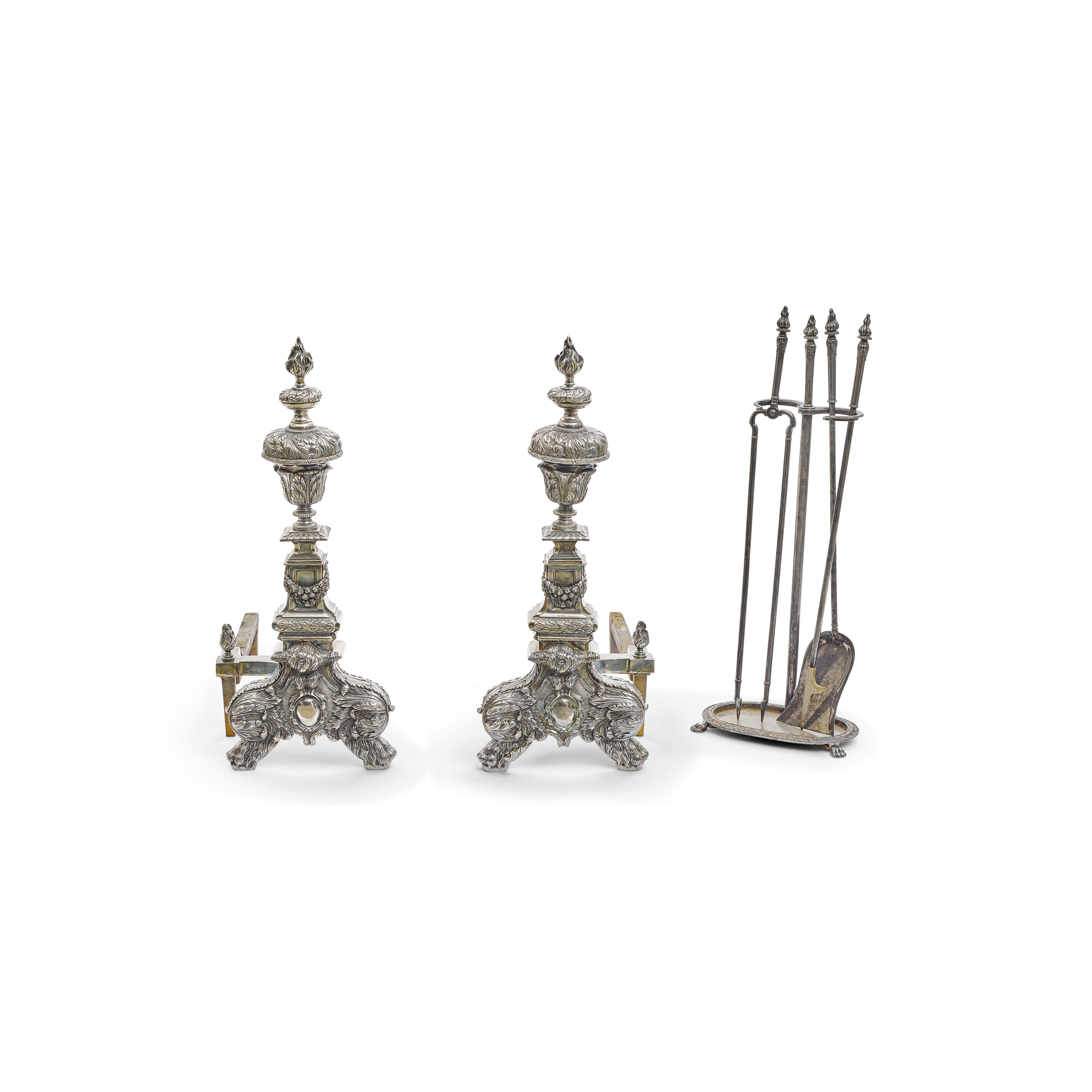 Lot 128 - A pair of English Baroque Style silvered bronze and metal andirons with tools and stand 19th century