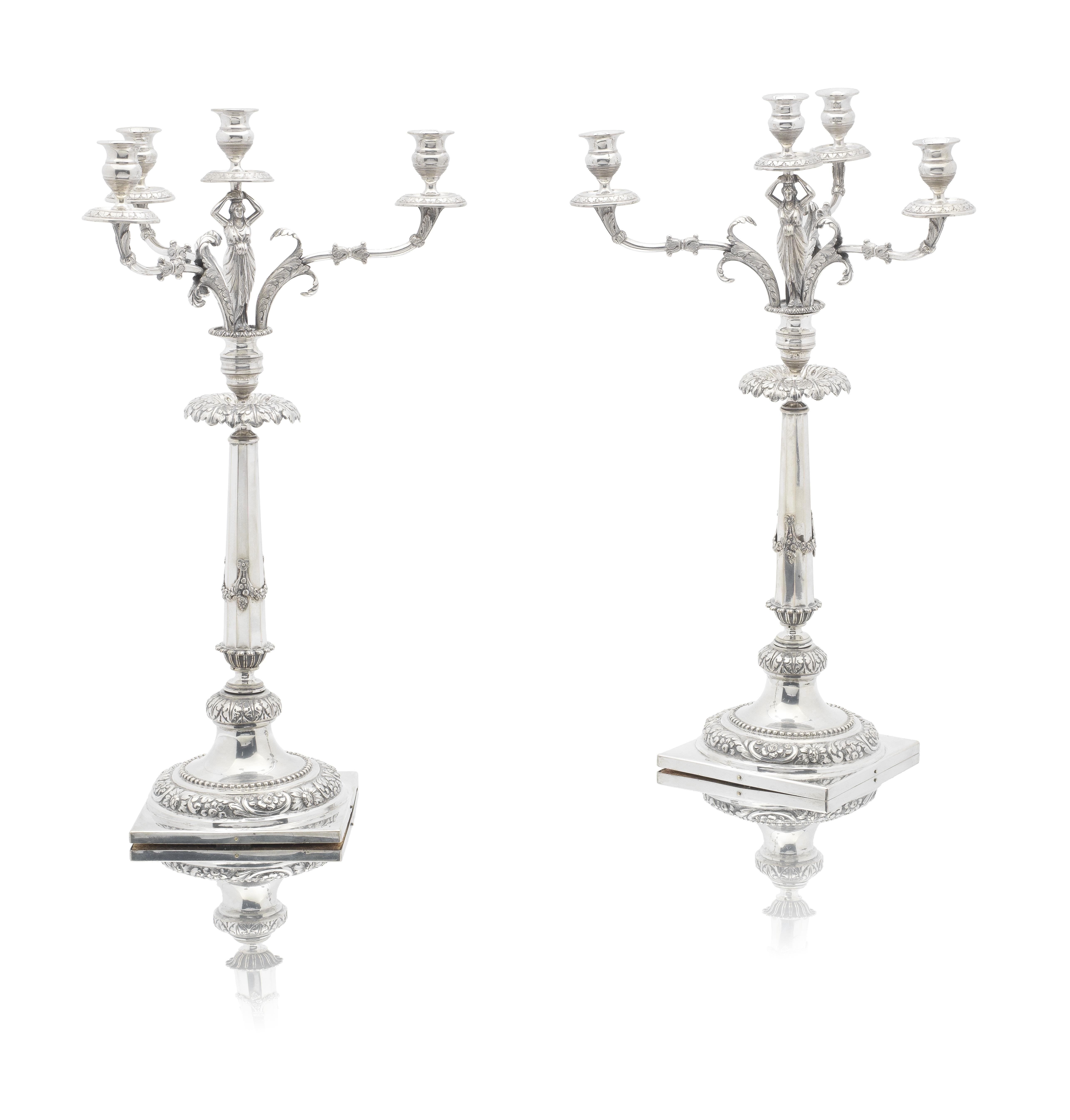 Lot 21 - A pair of Italian silver candelabra Scheggi, Florence circa 1820 (2)