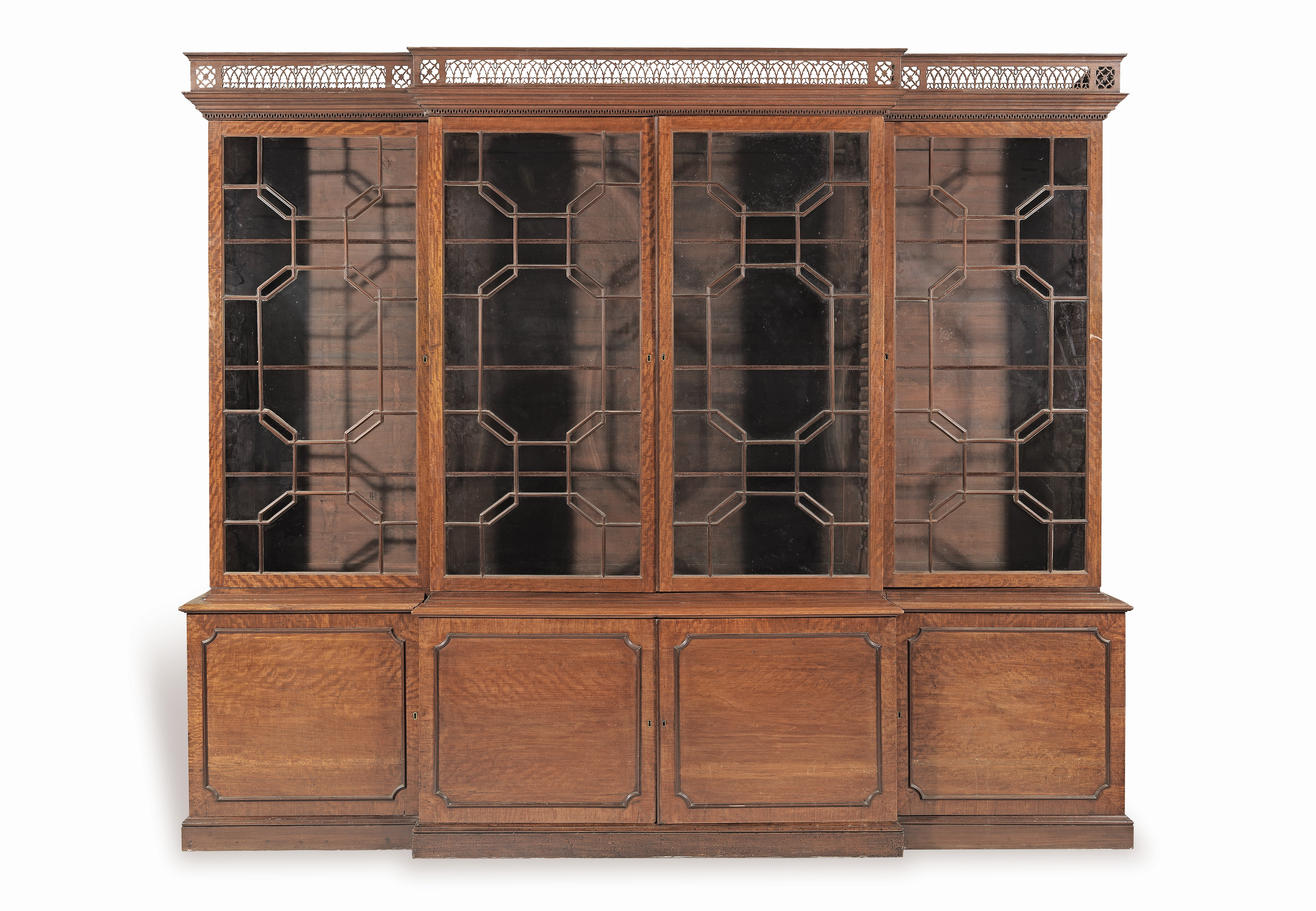 Lot 12 - A large George III mahogany breakfront bookcase