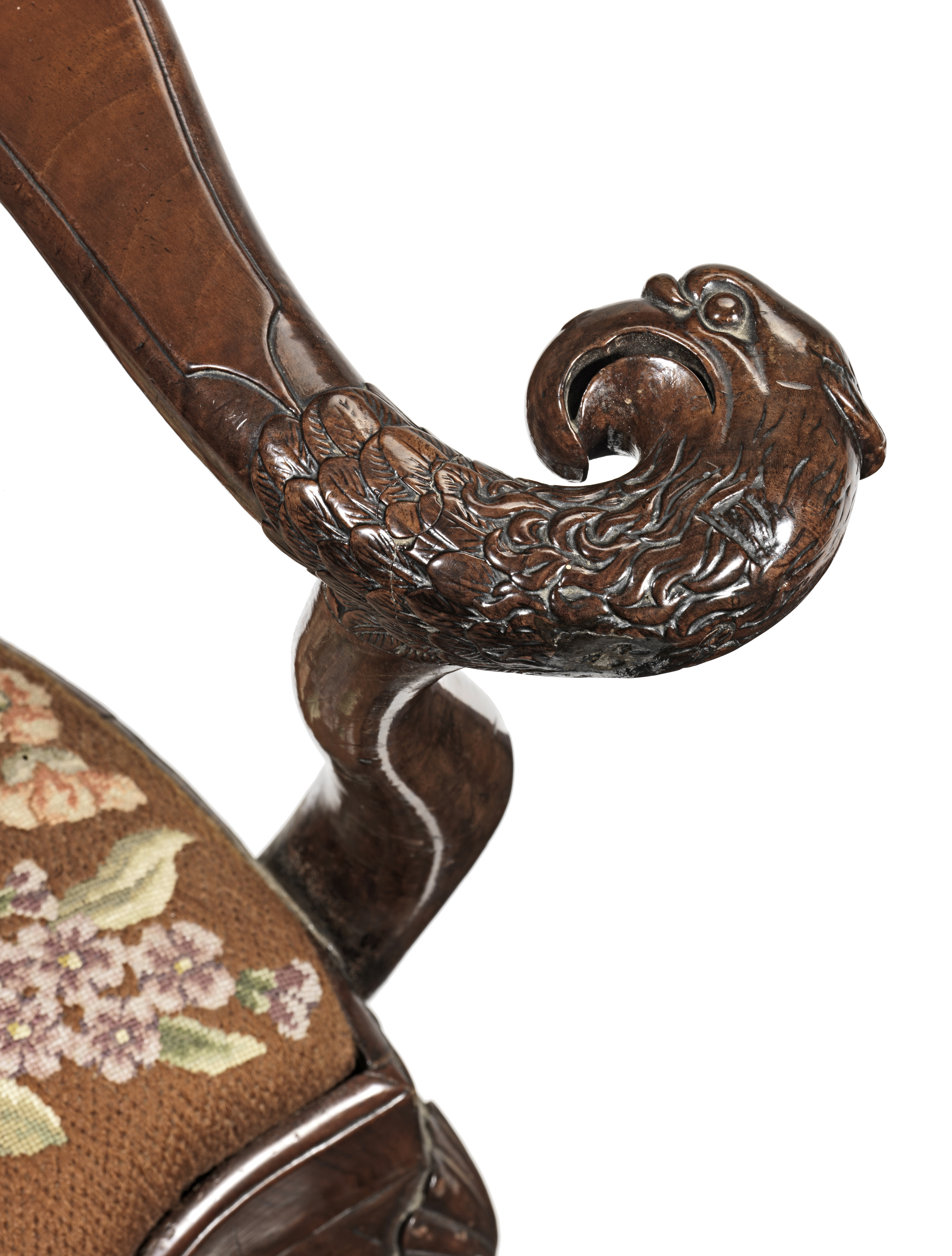 Lot 45 - A George I carved and figured walnut corner or 'writing' armchair in the manner of William Hallett