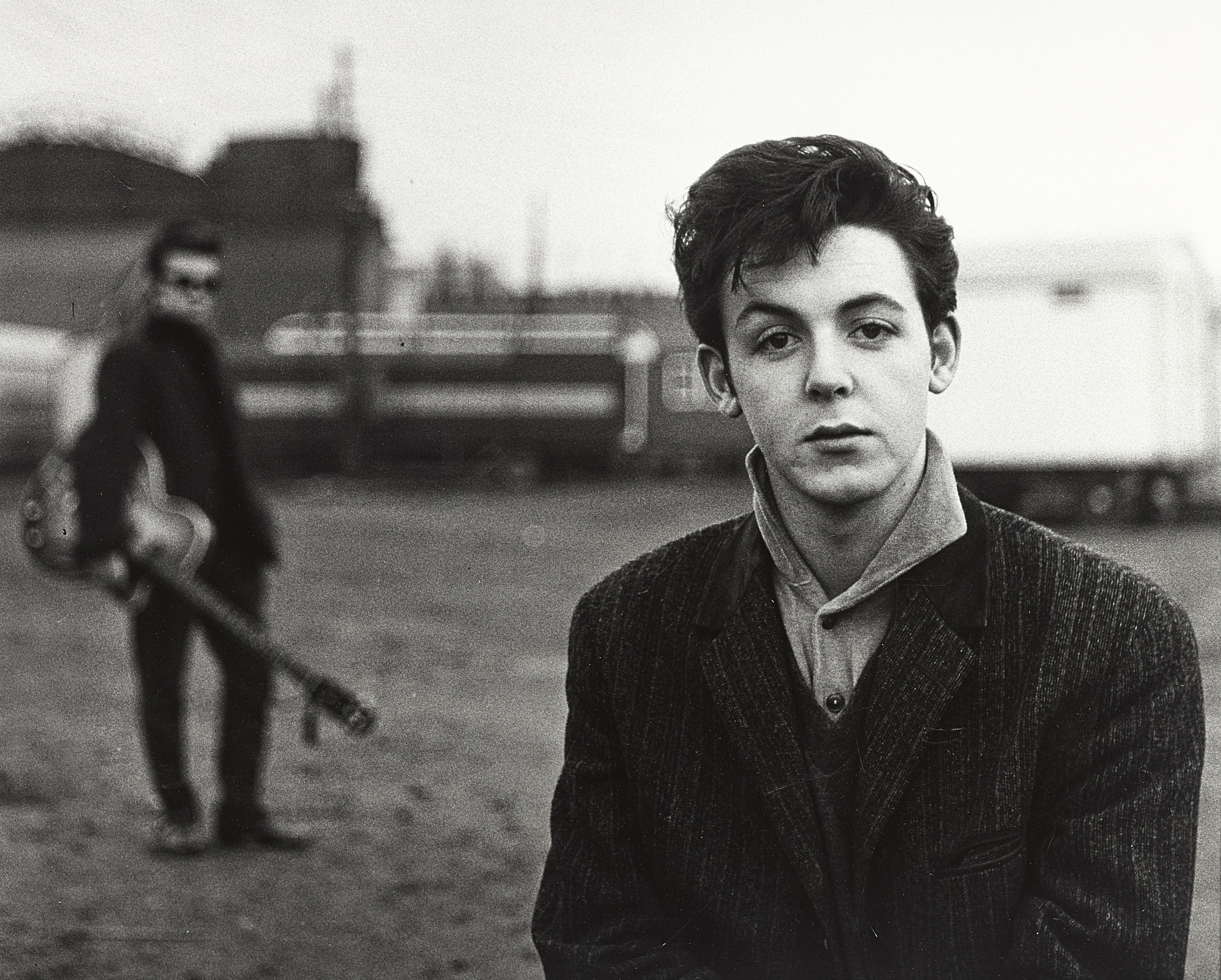 Lot 6 - A Photograph Of Paul McCartney And Stuart Sutcliffe, Hamburg Fun Fair By Astrid Kirchherr (German...