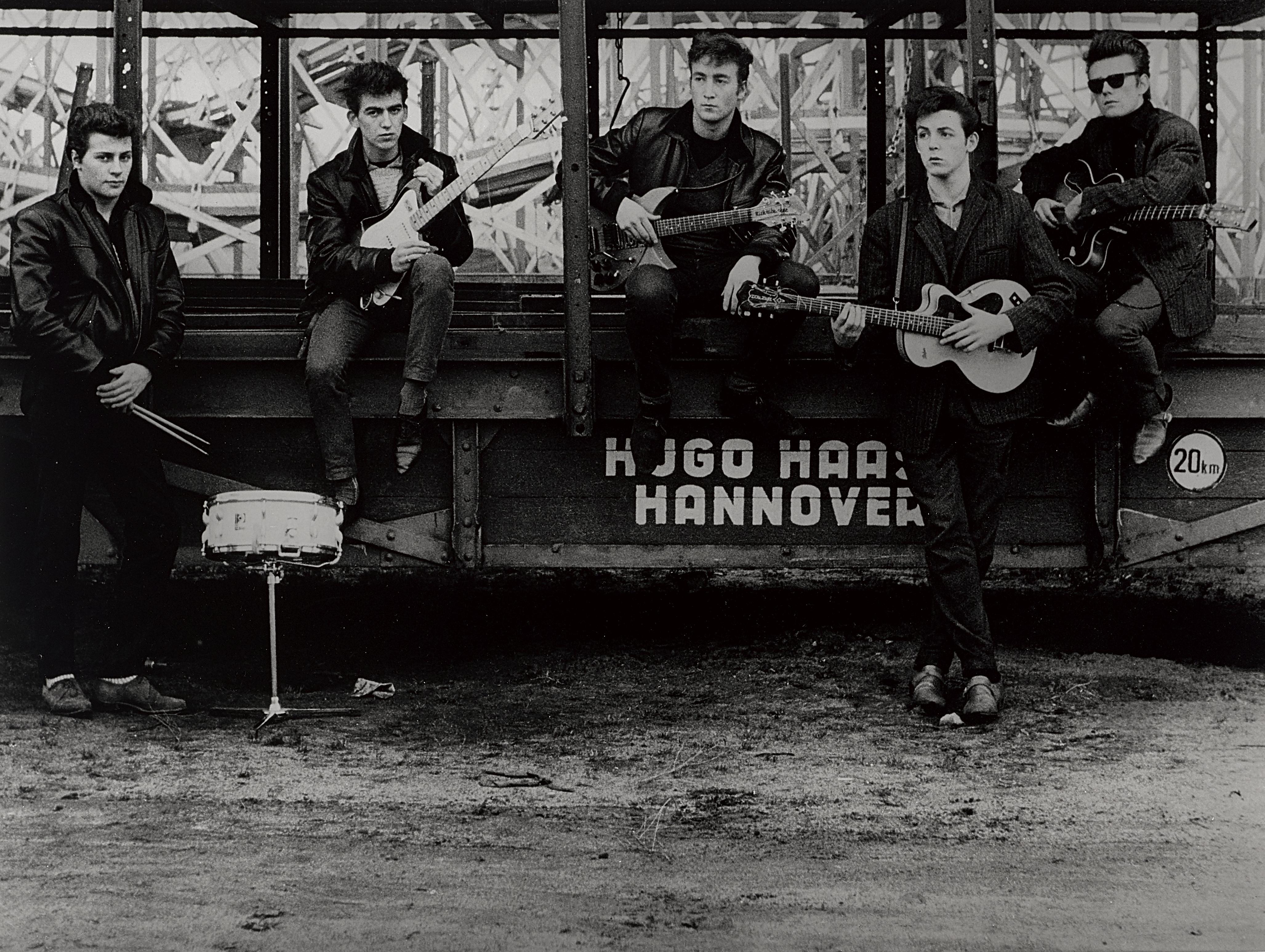 Lot 10 - A Photograph Of The Beatles, Hamburg Fun Fair By Astrid Kirchherr (German, Born 1938) 1960