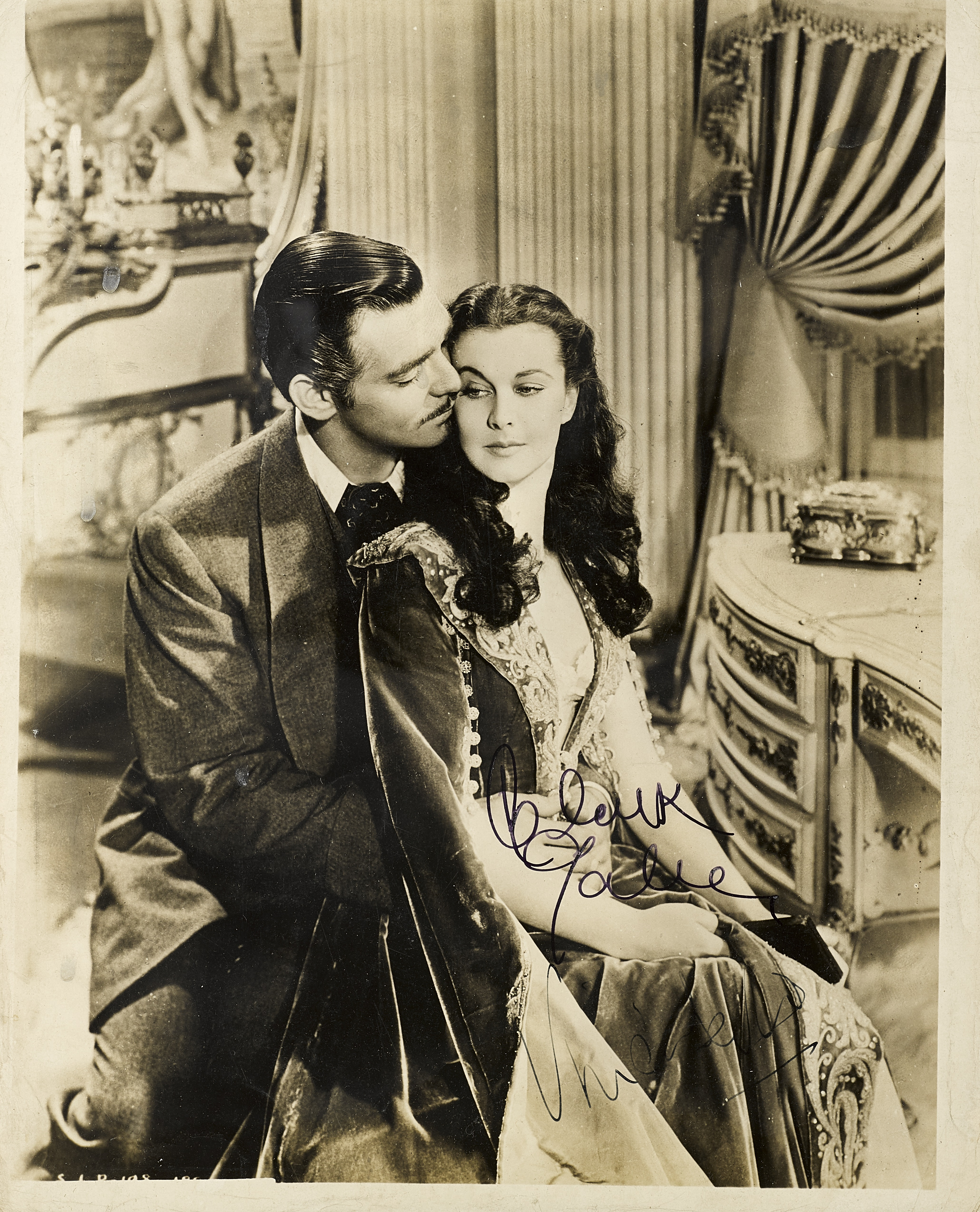 Lot 1058 - A Clark Gable and Vivien Leigh signed photograph from Gone With the Wind
