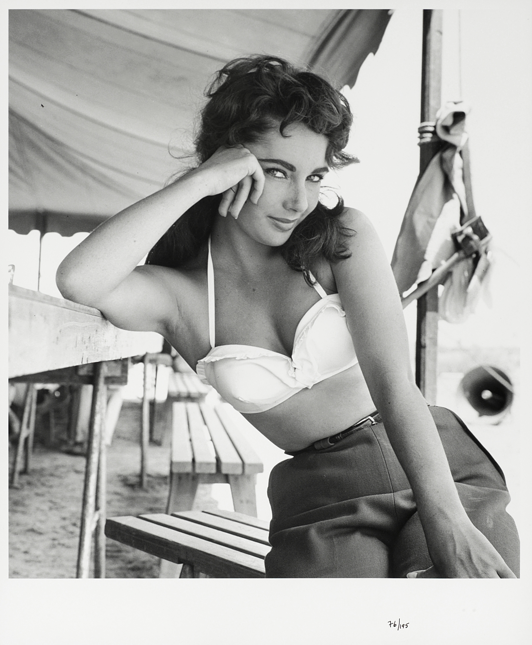 Lot 8 - Frank Worth (American, b.1923-d.2000): A black and white photographic print of Elizabeth Taylor, ...