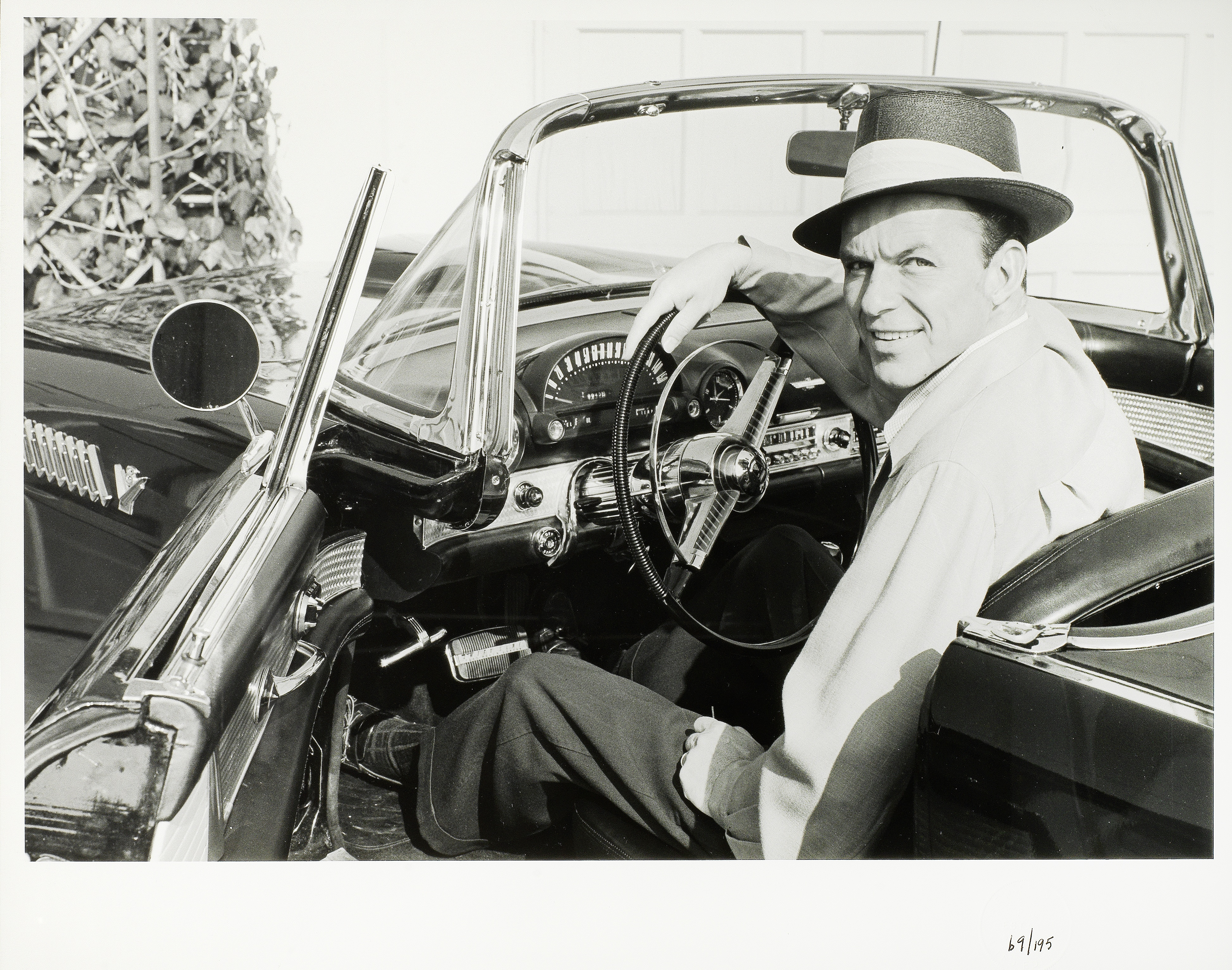 Lot 7 - Frank Worth (American, b.1923-d.2000): A black and white photographic print of Frank Sinatra, 195...