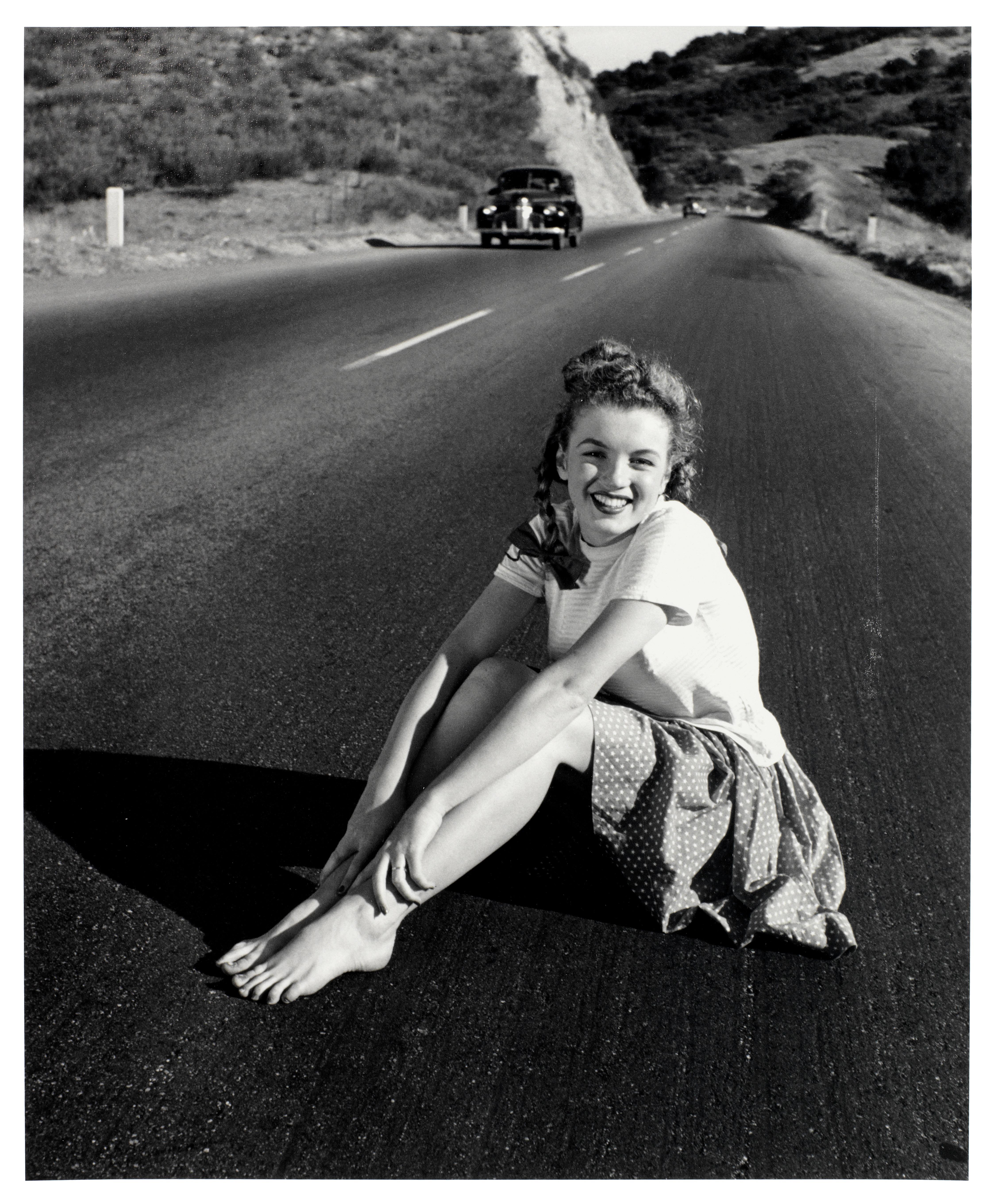 Lot 3 - Andre de Dienes (Romanian/American, b.1913-d.1985): a silver gelatin print of a young Marilyn Mon...