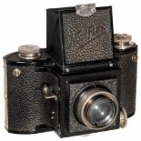 Noviflex by Eichapfel, 1934B. Eichapfel, Dresden. First camera of this style, beating the better