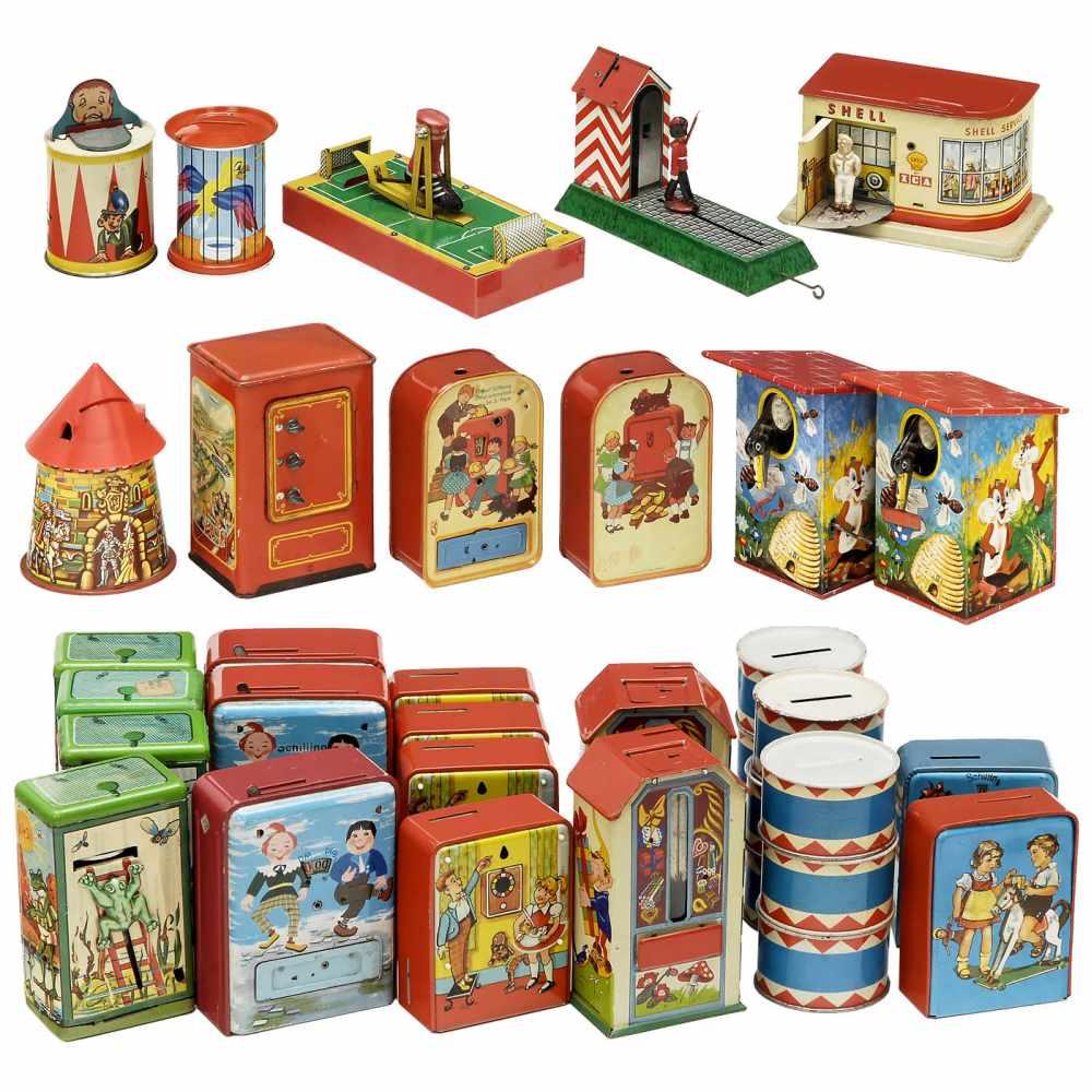 Lot 9 - 35 German Toy Money Banks, 1950-70Lithographed tin, manufactured by Geobra, Michael Seidel, Lorenz
