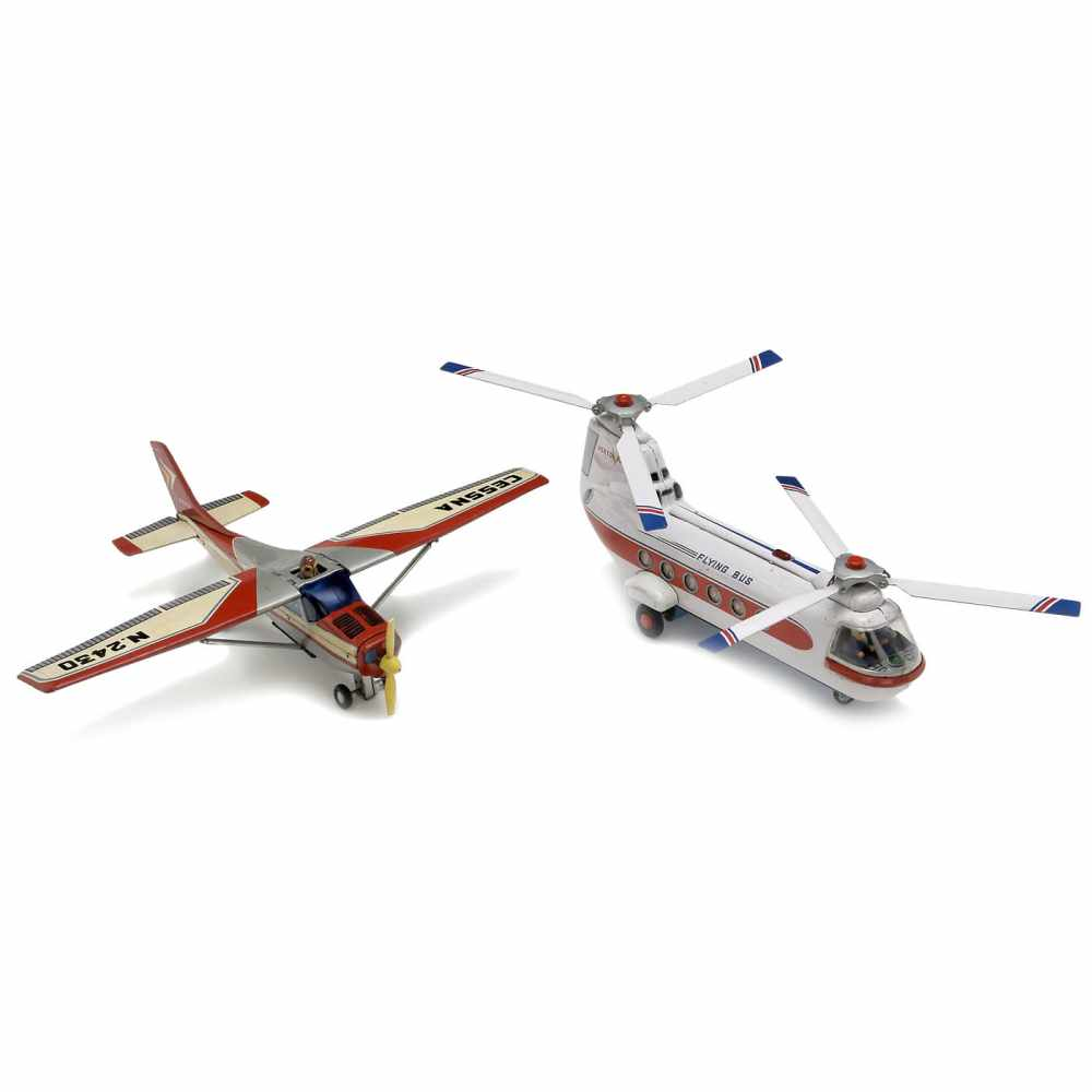 Lot 49 - 2 Japanese Tinplate Toy Airplanes, c. 1960Lithographed tin, battery-operated (untested). 1) Flying