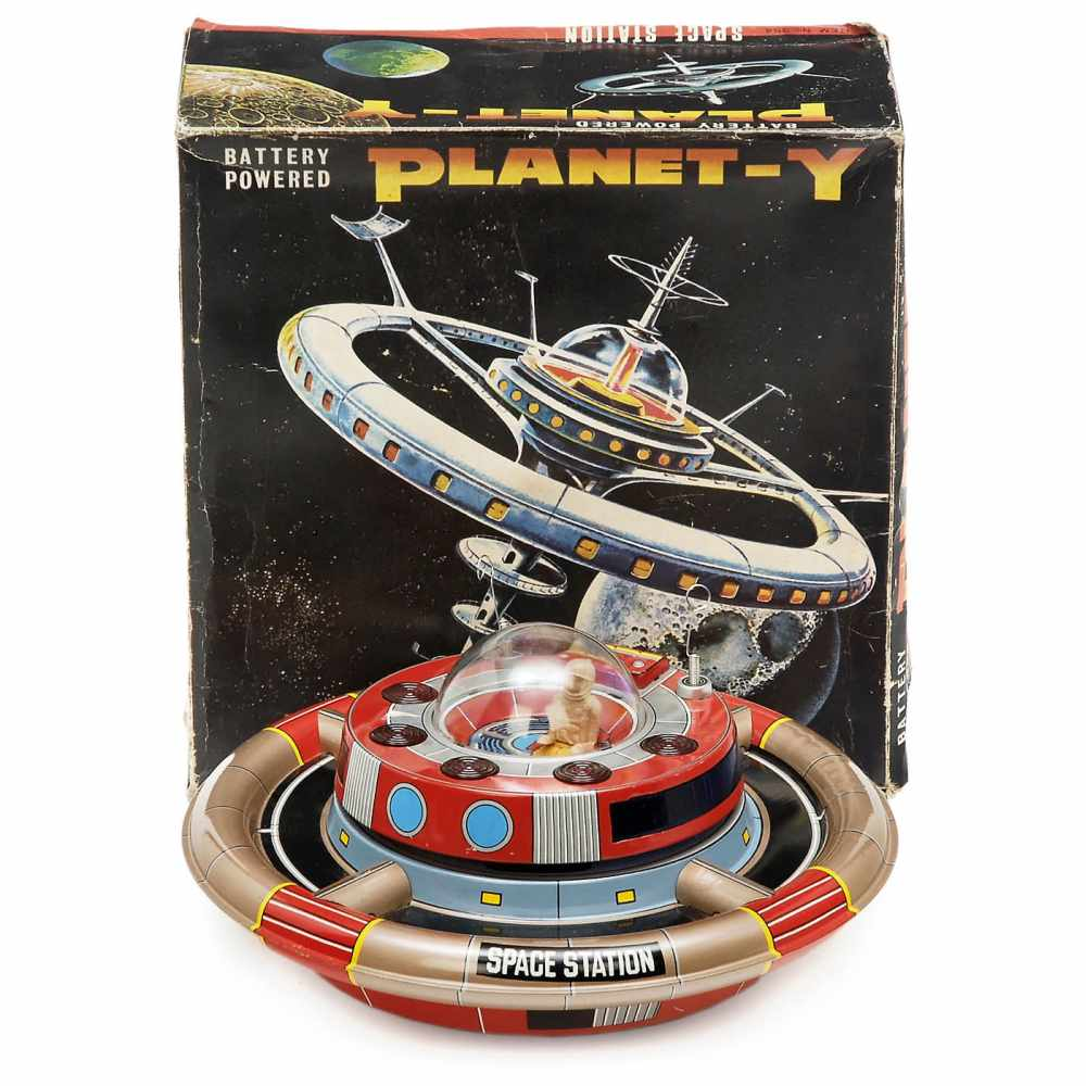 Lot 12 - Planet-Y Space Station, c. 1968Made by Nomura, Japan. Lithographed tinplate flying saucer, battery-