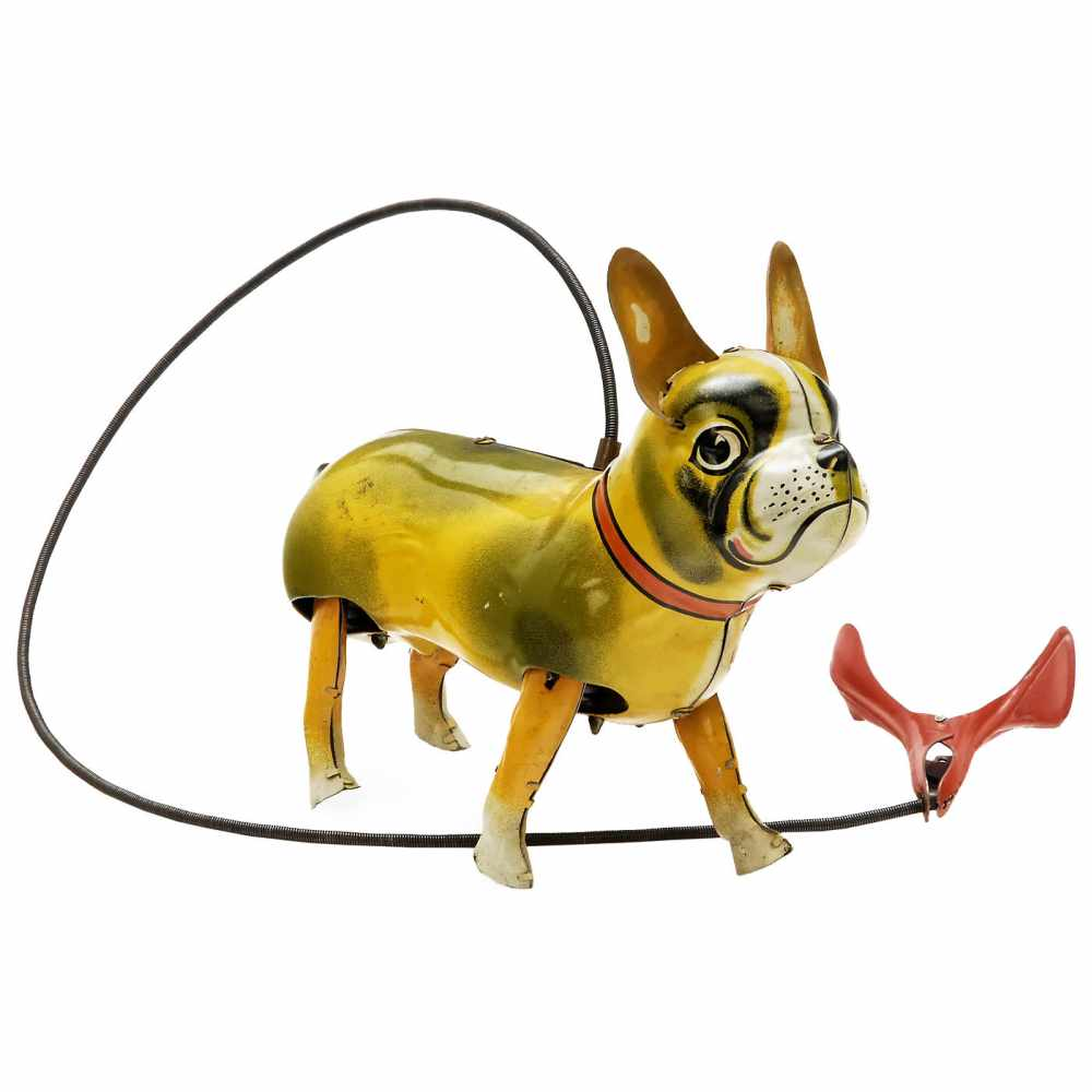 Lot 38 - Walking Bulldog Toy by Blomer & Schüler, c. 1955Nuremberg, Germany. Lithographed tin, remote-