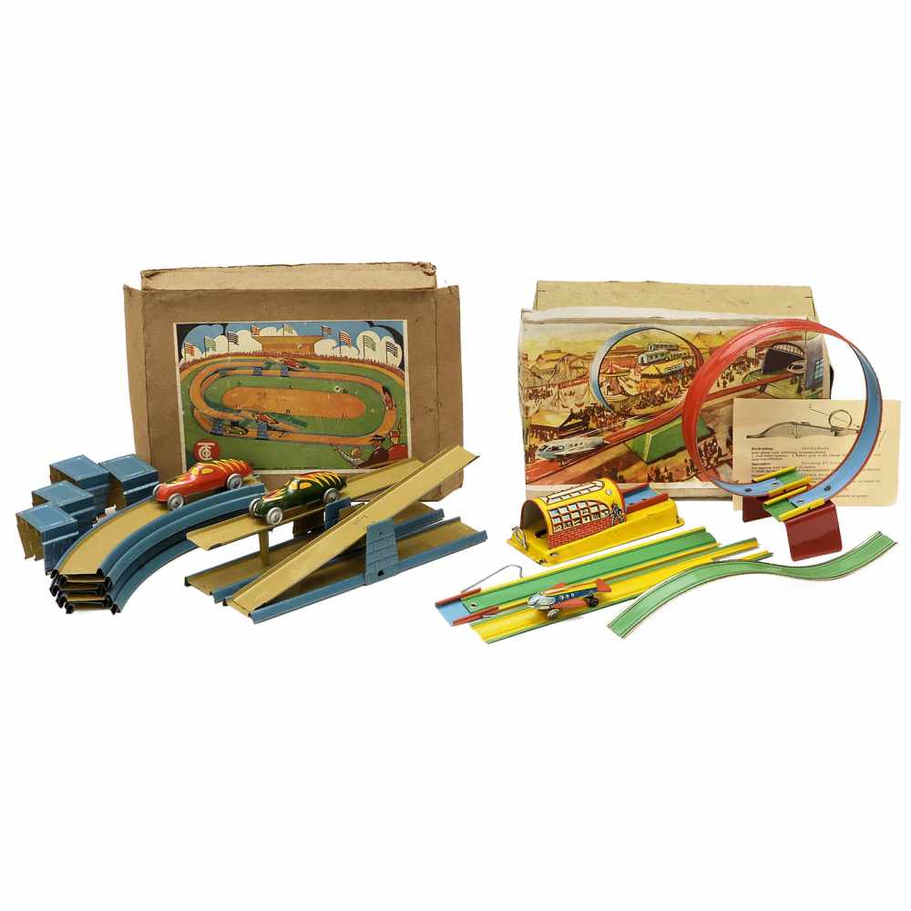 Lot 36 - 2 Tinplate Racetracks, c. 19501) Rocket track no. 6, Fritz Voit, Zirndorf. Spring-powered, with
