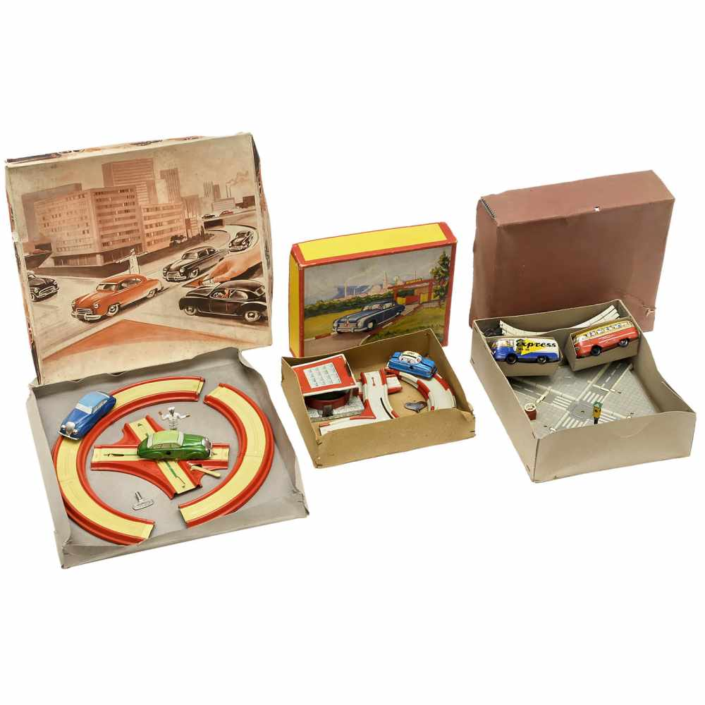 Lot 51 - 3 Tinplate Motorway Tracks, c. 1950Lithographed tin, spring-driven (all working), original boxes (