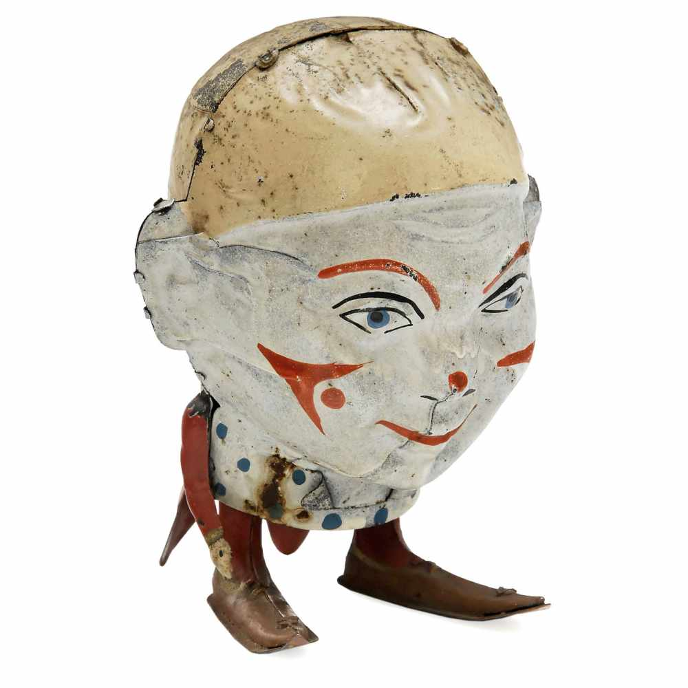Lot 3 - Big-Footed Head by Siegfried Günthermann, c. 1920Nuremberg, hand-painted tin, spring-driven (