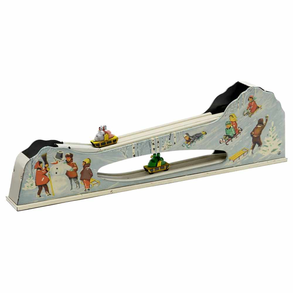 """Lot 8 - Tinplate Toboggan Run, c. 1955Marked """"A.M."""", France or Germany. Lithographed tin, spring-driven"""
