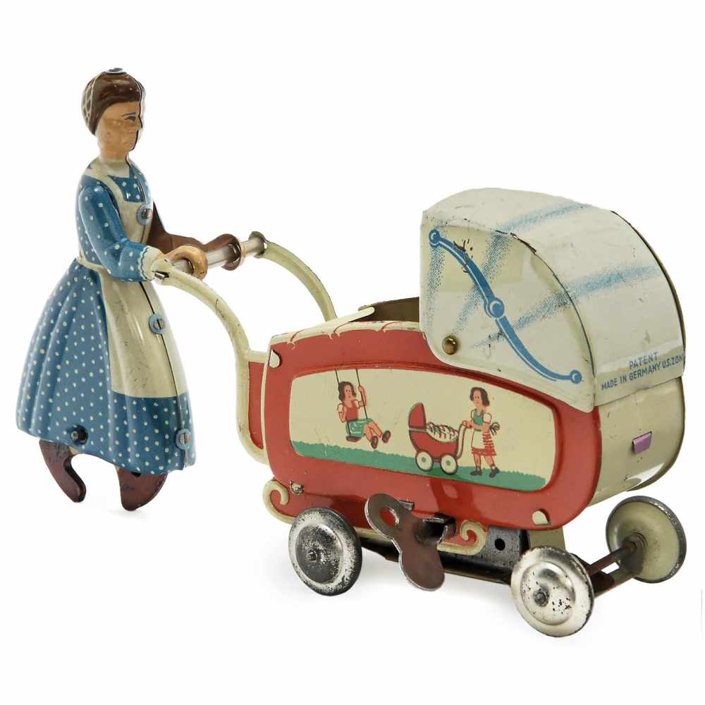 Lot 5 - Maid with Pram by Fritz Voit, c. 1950Fritz Voit, Zirndorf, Germany. Lithographed tin, spring-